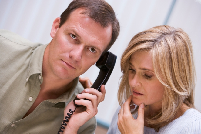 Couple receiving bad news over phone